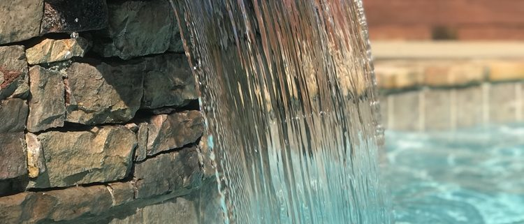 How do you install natural stone swimming pool lining?