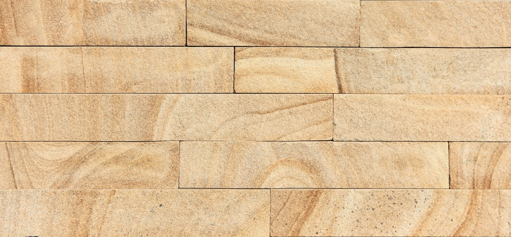 Are sandstone tiles suitable for salt water pool design?